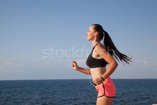 girl goes in for sports training on the beach Stock photo © dmitriisimakov