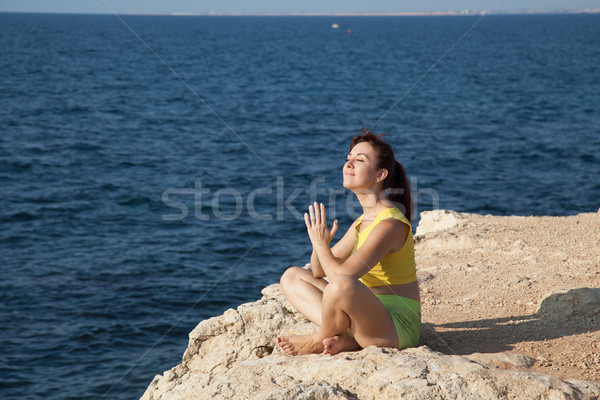 girl meditating on the beach by the sea Stock photo © dmitriisimakov