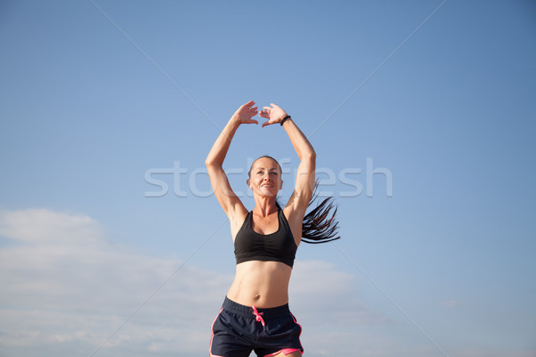 woman goes in for Sports Fitness on the beach Stock photo © dmitriisimakov