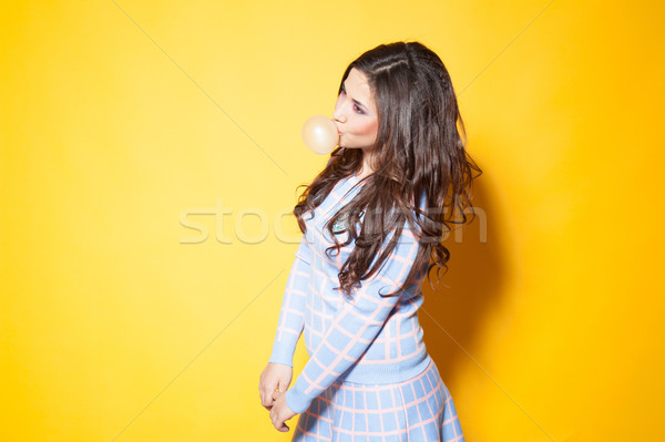 Stock photo: girl with chewing gum in your mouth
