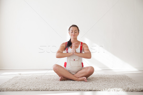 a pregnant woman is engaged in gymnastics and yoga Stock photo © dmitriisimakov