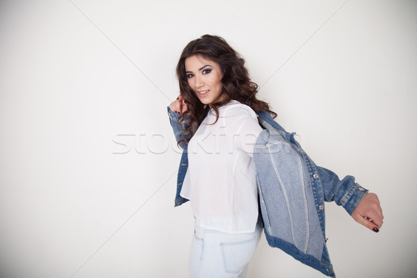 beautiful girl posing on a white background curls hairstyle Stock photo © dmitriisimakov