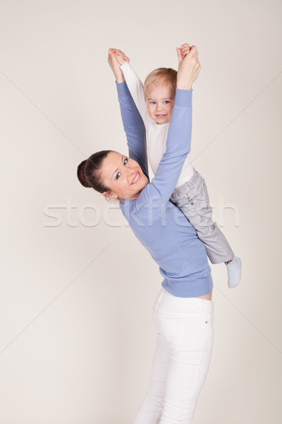 mom raises her son hands up Stock photo © dmitriisimakov