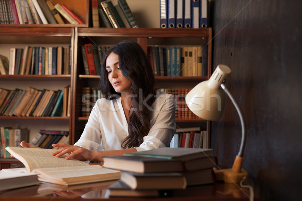 girl is preparing for the exam reading book at the library Stock photo © dmitriisimakov