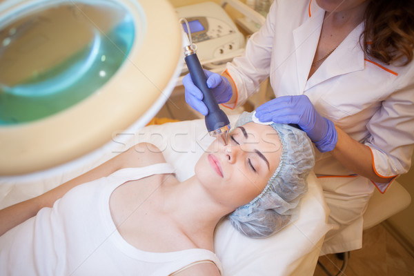 Stock photo: doctor beautician treats a person girl in Spa 1