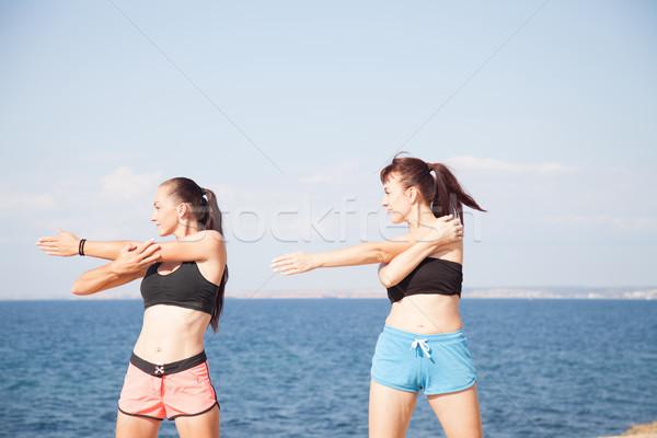 two girls play sports fitness on the beach Stock photo © dmitriisimakov