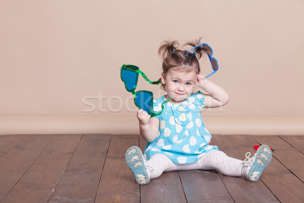 little girl plays with big glasses, she funny Stock photo © dmitriisimakov