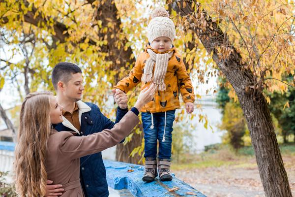 Aile sonbahar orman yürümek gülümseme Stok fotoğraf © dmitriisimakov