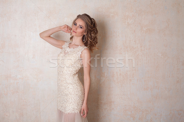 girl in a wedding dress stands in a white room wedding Stock photo © dmitriisimakov