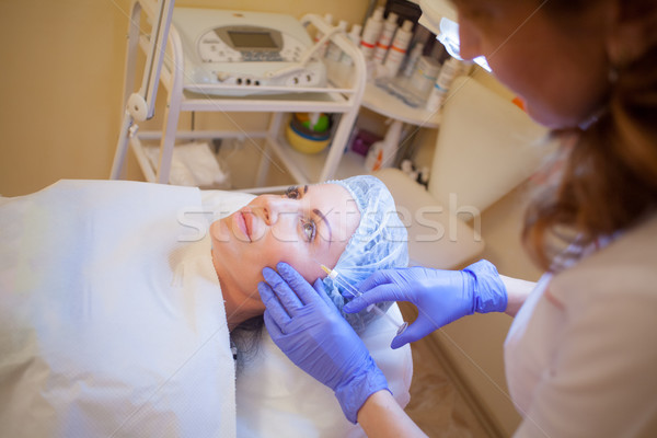 doctor beautician increases lip patient an injection syringe Spa Stock photo © dmitriisimakov