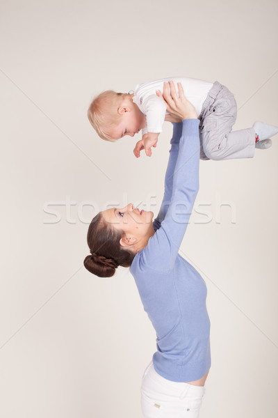 mom raises her son hands up Stock photo © dmitriisimakov