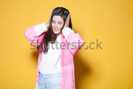 bright girl surprised closed her eyes with hands Stock photo © dmitriisimakov
