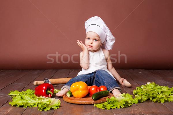 boy chef prepares carrots, pepper, Tomato Cucumber Stock photo © dmitriisimakov