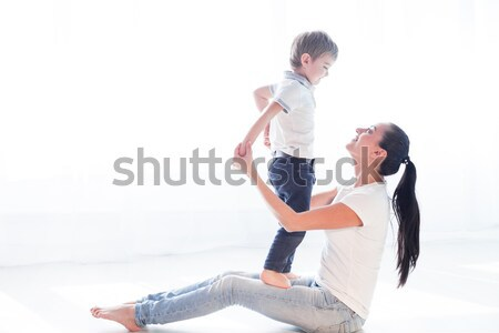 mom plays with her son on the floor of the happiness Stock photo © dmitriisimakov