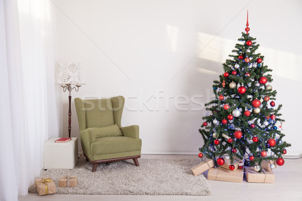 Christmas tree in a white room on new year's Eve Stock photo © dmitriisimakov