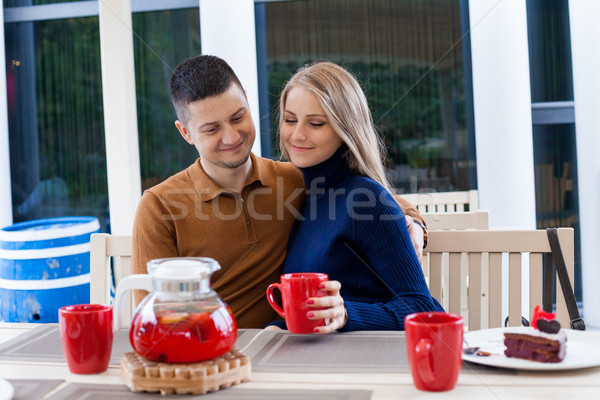restaurant on the street. a guy with a girl drink hot coffee and tea Stock photo © dmitriisimakov