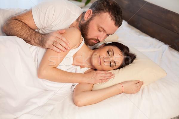 guy with girl, wake up in the morning in the bedroom Stock photo © dmitriisimakov