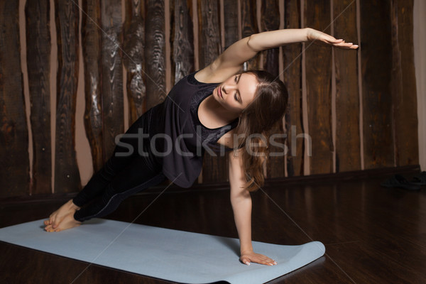 Woman is in Side Plank pose Stock photo © dmitroza