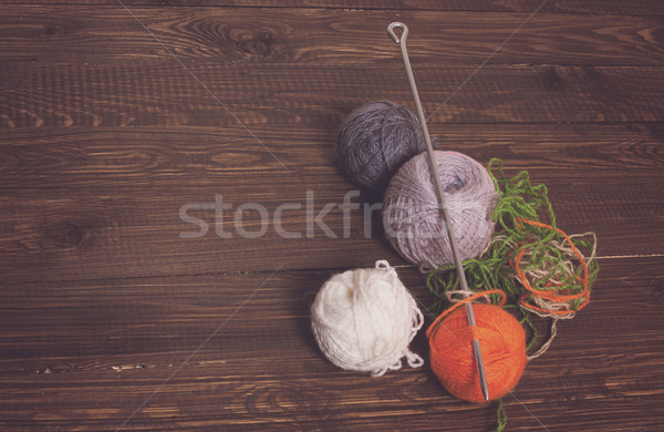 Clews of threads and needle Stock photo © dmitroza