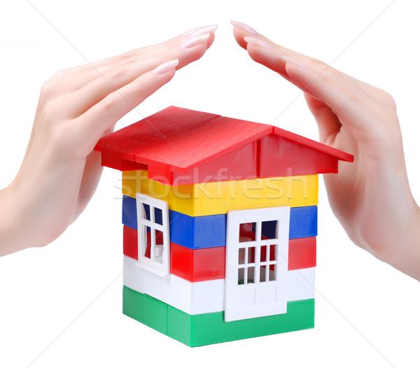 Handen speelgoed kleur huis jonge vrouw Stockfoto © dmitroza