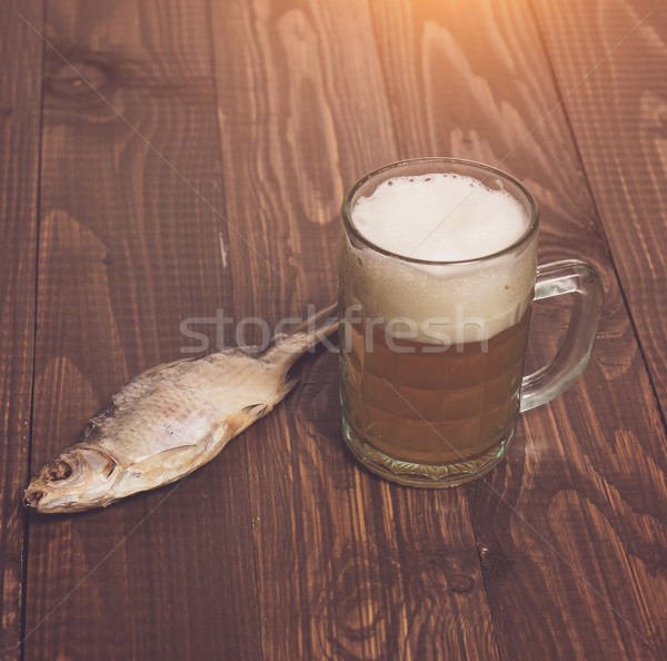 One fish with frothy beer Stock photo © dmitroza