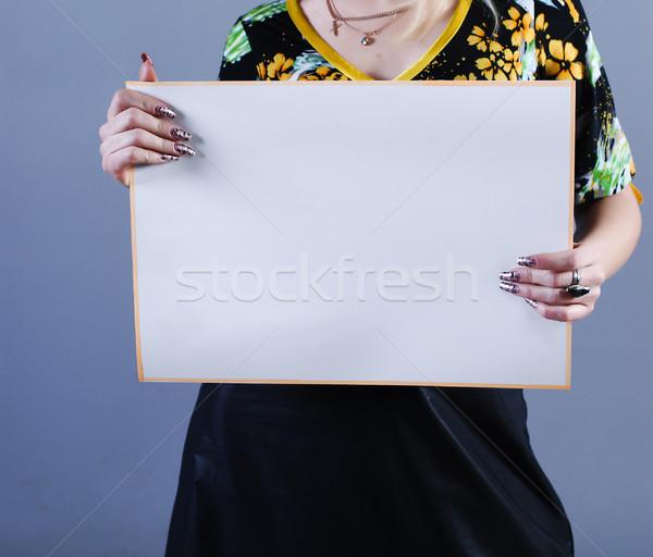 Woman takes placard  Stock photo © dmitroza