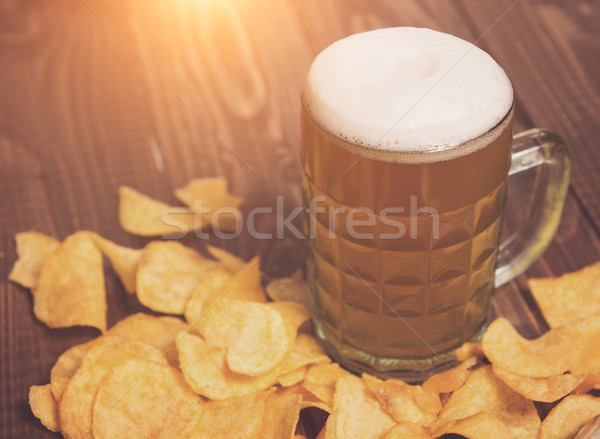 Beer and chips all around Stock photo © dmitroza