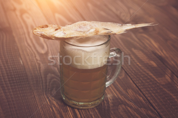 Fish on frothy beer Stock photo © dmitroza