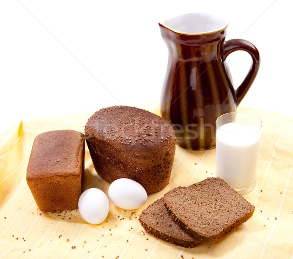 Stock photo: Brown bread with milk