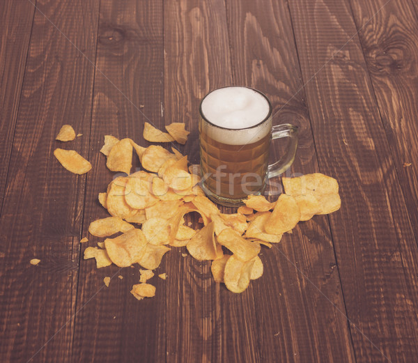 Beer and crunchy chips Stock photo © dmitroza
