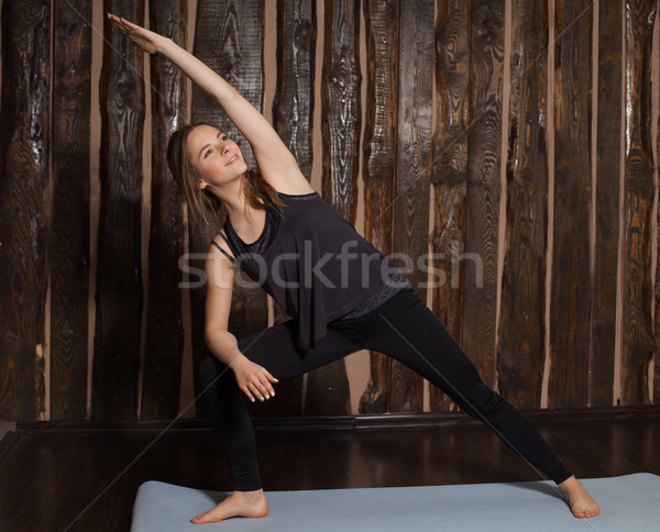 Woman is in side angle pose Stock photo © dmitroza