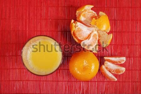 Glas sap mandarijn sinaasappelsap Rood achtergrond Stockfoto © dmitroza