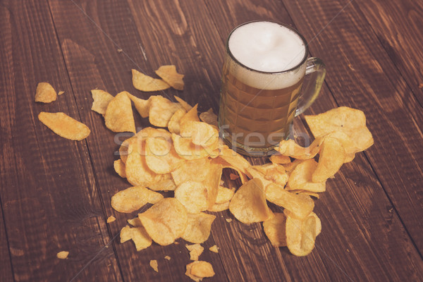 The beer and crunchy chips Stock photo © dmitroza