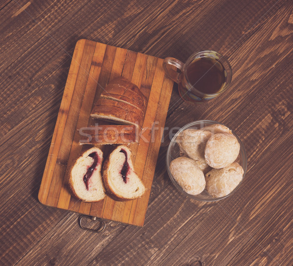 Tasty buns with tea and cutted loaf Stock photo © dmitroza