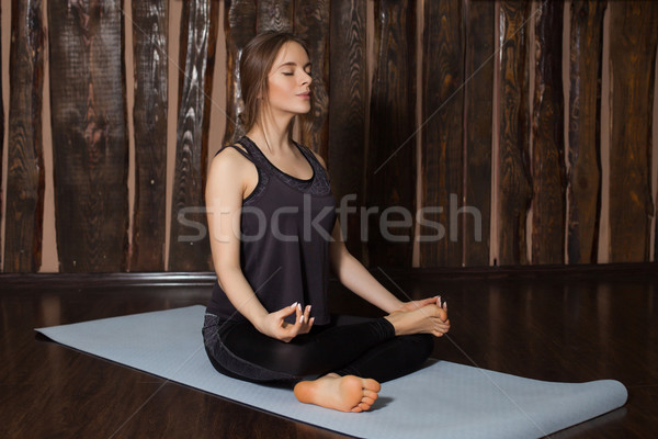 Woman is concentrating for yoga Stock photo © dmitroza