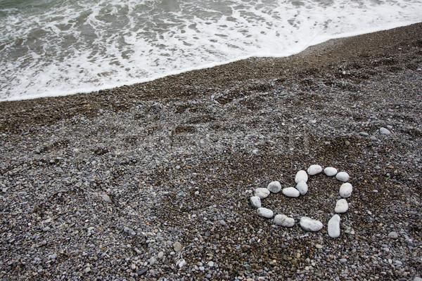 Pedra mar forma coração praia água Foto stock © dmitroza