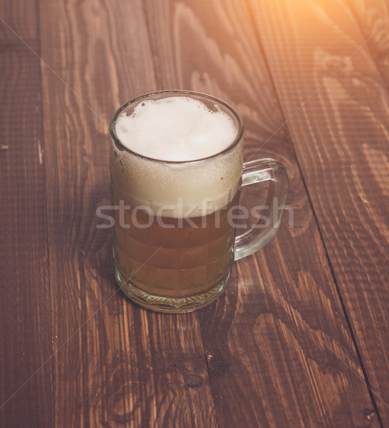 Frothy beer on table Stock photo © dmitroza