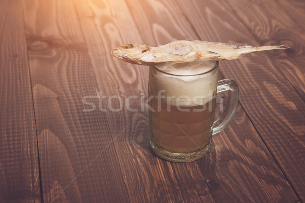 Salted fish on beer Stock photo © dmitroza