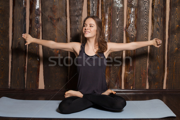 Stock photo: Woman is preparing for yoga