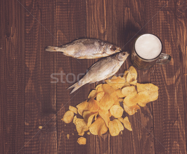 Chips, beer and two fishes Stock photo © dmitroza