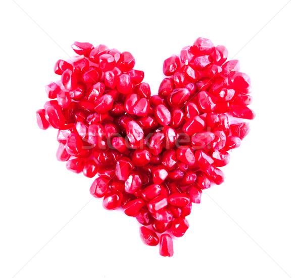 Cuore melograno rosso semi isolato Foto d'archivio © dmitroza