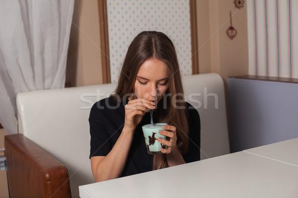 Young woman drinking coffee Stock photo © dmitroza