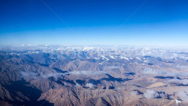 Himalayas bergen luchtfoto wolken hemel televisie Stockfoto © dmitry_rukhlenko