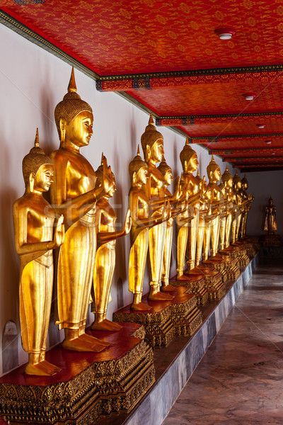 Standing Buddha statues. Thailand Stock photo © dmitry_rukhlenko