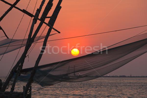 Chinese fishnets on sunset. Kochi, Kerala, India Stock photo © dmitry_rukhlenko