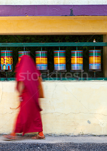 Buddhist monk rotating prayer wheels in McLeod Ganj Stock photo © dmitry_rukhlenko