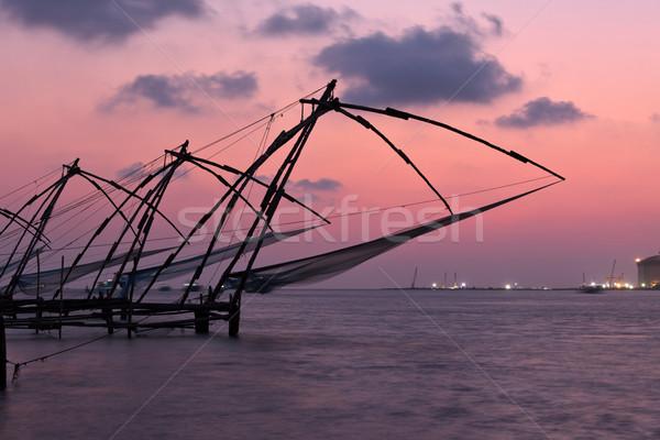 Chinois coucher du soleil Inde fort soleil silhouette Photo stock © dmitry_rukhlenko
