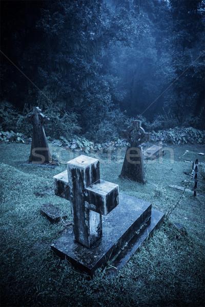 Spooky Halloween graveyard in fog Stock photo © dmitry_rukhlenko