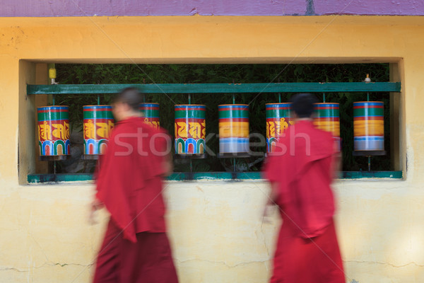 Buddhist monks rotating prayer wheels in McLeod Ganj Stock photo © dmitry_rukhlenko
