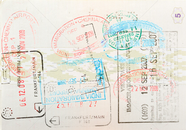 Passport page with immigration stamps Stock photo © dmitry_rukhlenko
